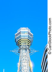 Tsutenkaku Tower in Shinsekai new world district with blue...