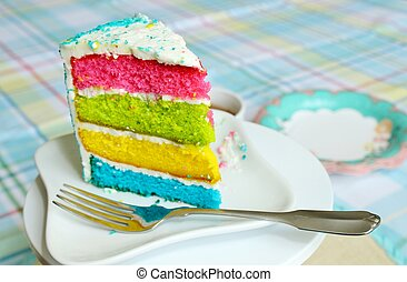 A slice of cake with white frosting