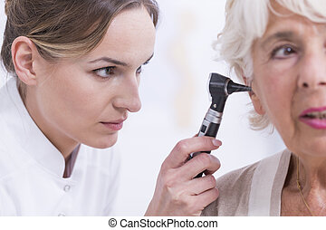 Senior with hearing problem