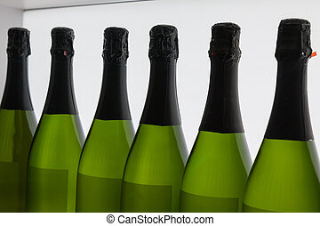 White Wine's Bottles in Line, inside Green Glass