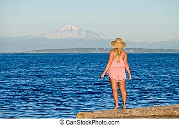 Young woman on bech by ocean - Centennial Beach in Boundary...