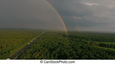 Aerial view of highway in forest, colorful rainbow, Netherla...