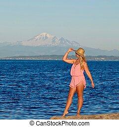 Young woman on bech by ocean. - Centennial Beach in Boundary...