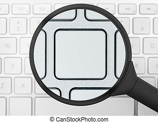 Magnifying glass over a computer keyboard