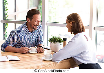 Overjoyed colleagues drinking coffee - Pleasant talk. Joyful...