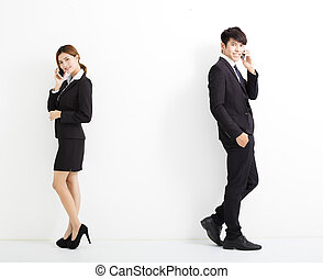 young business man and woman talking on the phone