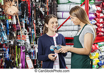 Happy Girl Buying Toy From Saleswoman In Pet Store - Happy...