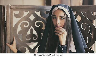 bad nun looks and kiss cross - sexy bad nun with cross