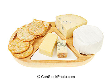 Cheeseboard with cheeses and biscuits on white