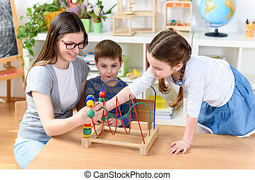 Kids with teacher playing games