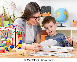 Kid with teacher playing games