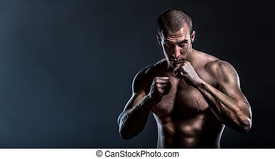 tough man in fighting stance - muscular powerful man in full...