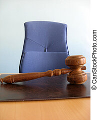 Courts room - Old wooden gavel ,blue chair and court desk