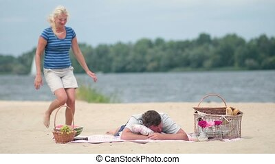 Family Having Piggyback Fun On Beach Holiday