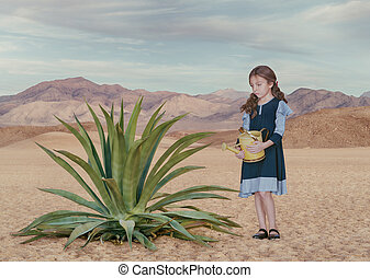 Portrait of little white girl with watering can in desert...