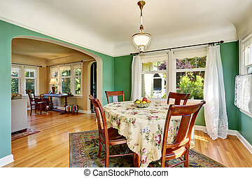 Traditional dining area with wooden table set. Open floor...