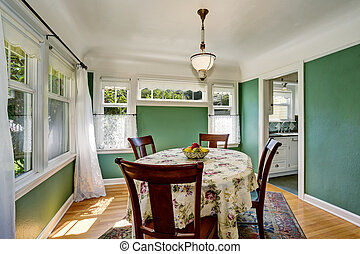 Traditional dining area with wooden table set Open floor...