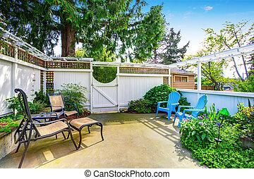 Yellow house backyard area with patio