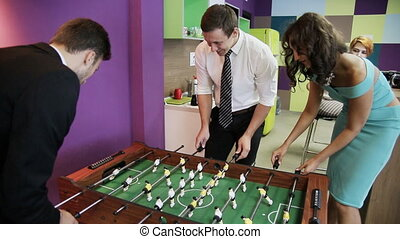 Office workers playing kicker
