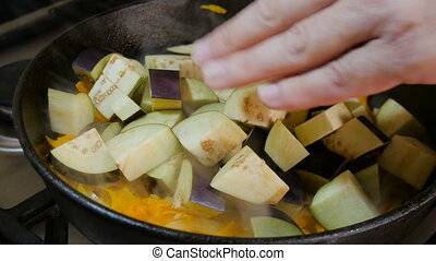 Eggplant cooked in a roasting pan with the onions and...