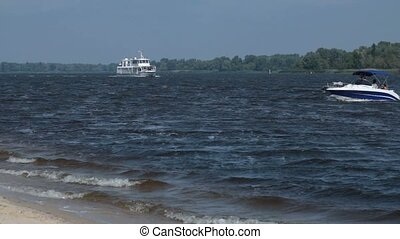 Cruise ship floating the river in summertime. Panoramic view...