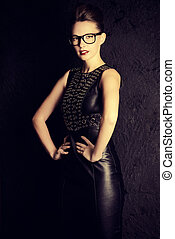 strict woman - Attractive young woman alluring in black...