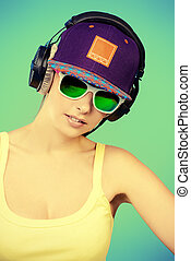 musical girl - Modern young woman enjoys listening to music...