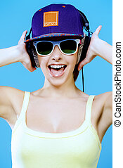 excited by music - Modern girl enjoys listening to music in...