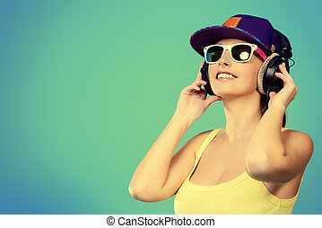 devoted to music - Modern young woman enjoys listening to...