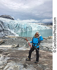 Woman climber standing near Jostedalsbreen glacier Norway