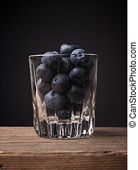 Super food with blueberries - Blueberries in a glass on a...