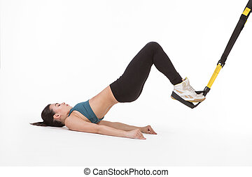 Woman training with suspension trainer sling - Core body...