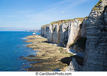 Etretat Aval cliff, rocks and natural arch landmark and blue...