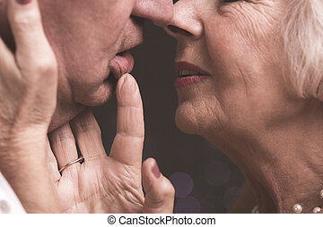 Just one more kiss - Close shot of elder couple close to...