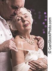 Gentle touch of beloved man - Shot of elder couple, when man...