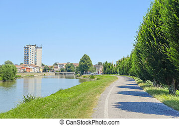 Adria, Italy - June, 29, 2016: embankment of Canalbianko...
