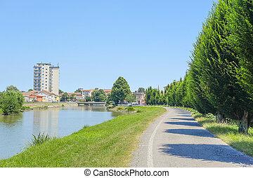 Adria, Italy - June, 29, 2016: embankment of Canalbianko...