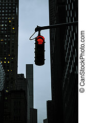 Red traffic light at the crossroads in NYC