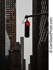 Red traffic light at the crossroads in NYC - Evening on the...