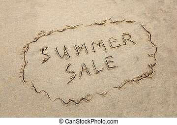 quot;Summer Salequot; written in the sand at the beach Sales...