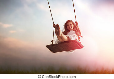 child girl on swing - Happy laughing child girl on swing in...