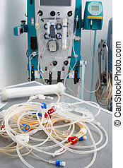 Blood tubes with hemodialysis machine in the background -...