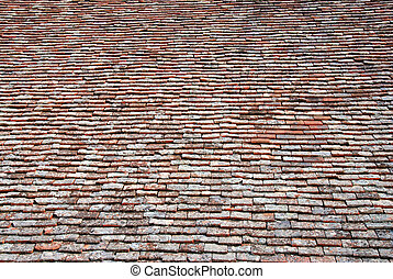 Symmetric textured brown background from church roof clay...