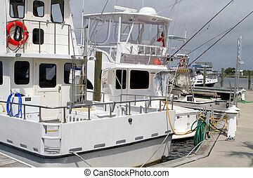 Fishing Charter Boats - Charter fishing boats sit idle at...