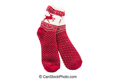 Red knitted sock lying on a white background