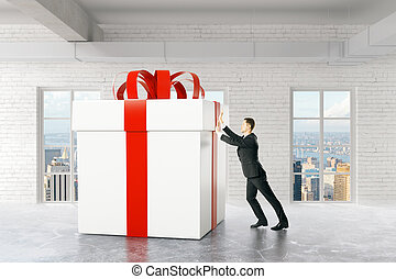 Businessperson pushing present box - Businessman pushing...