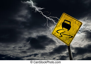 Slippery When Wet Road Sign With Stormy Background -...