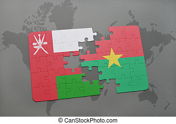 puzzle with the national flag of oman and burkina faso on a world map background.