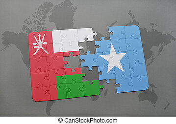 puzzle with the national flag of oman and somalia on a world...