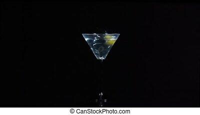 Olive falls into the martini glass HD